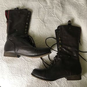 Brown Combat boots with flannel on the inside.